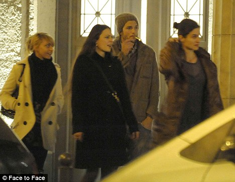 Ladies man? Shortly before Christmas Ashton was seen on a night out with three women in Berlin