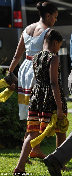 Seemingly simple: Michelle Obama's sundress for a church service at the Kaneohe Bay Marine Base on Christmas Day was by Sophie Theallet and would have set Mrs Obama back almost $2,000 when she bought it in 2009