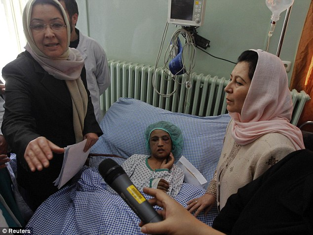 Action needed: Afghanistan's acting Minister of Public Health Suraya Dalil, left, and Afghanistan's caretaker Minister for Women's Affairs Dr Husn Banu Ghazanfar visit Sahar Gul in hospital