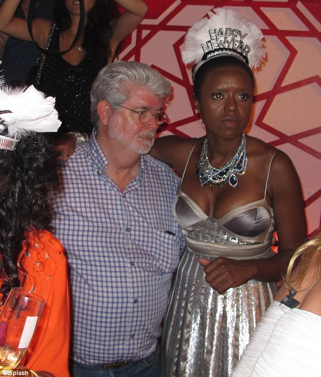 Figure-hugging: George Lucas's girlfriend Mellody Hobson's dress seemed rather tight