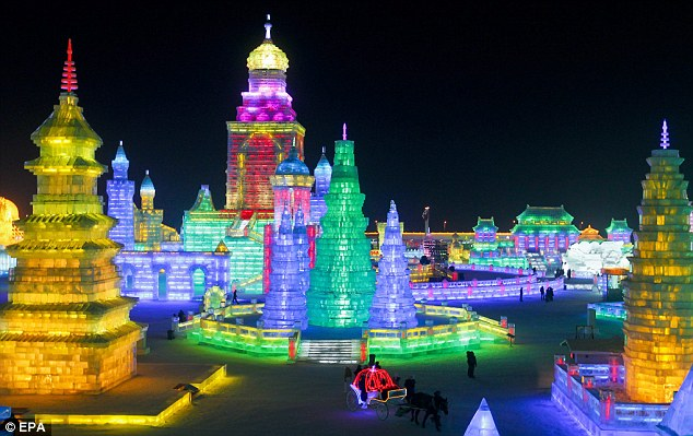 Have an ice day! A horse and carriage navigates the snow-covered streets of Harbin Ice and Snow Festival's impressive city