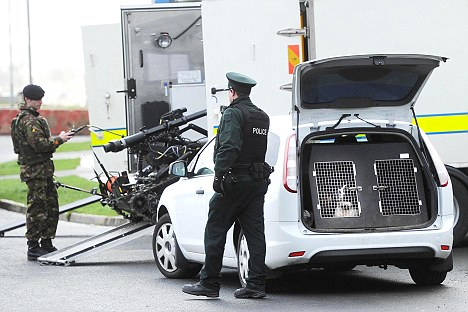 At the scene: A bomb disposal crew prepares to deal with the bomb planted in a British soldier's car in Belfast