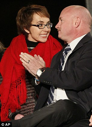 Moving forward: Gabrielle Giffords smiles broadly as the crowd chanted her name during the memorial vigil at the university