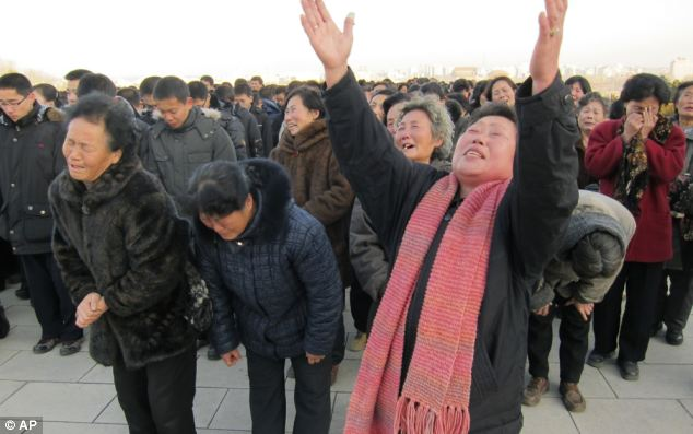 Display: North Koreans cry and scream in a display of mourning after Kim Jong-il's death was announced
