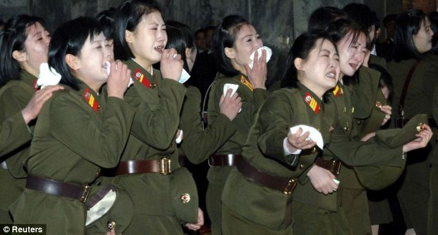 Hysteria: North Korean soldiers mourn Kim Jong-il at the Kumsusan Memorial Palace