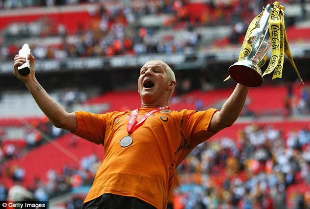 Glory days: Dean Windass celebrates Hull's victory in the 2008 Coca Cola Championship Playoff Final match. He scored the goal that took his home-town club into the top flight for the first time and was nominated man of the match