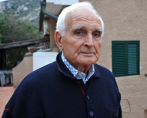 Guiseppe Tievoli stands by the window his son Antonelli, maitre d' on the cruise ship Costa Concordia, told him to look out of as the ship passed by, close to shore