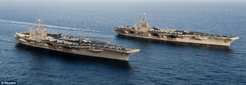 Flotilla: The Nimitz-class aircraft carriers USS John C. Stennis (R) and USS Abraham Lincoln that sailed through the Strait of Hormuz yesterday