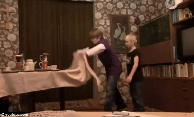 Ready: The older boy, Sven, pulls the table cloth with Michel standing behind him