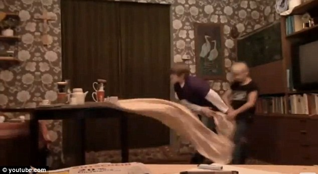 Oops! Sven pulls the cloth back - but knocks into Michel causing to fall back on the cabinet