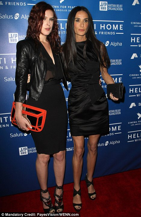 Seeking help: Demi Moore, seen here earlier this month with her daughter Rumer has gone into hospital to treat exhaustion