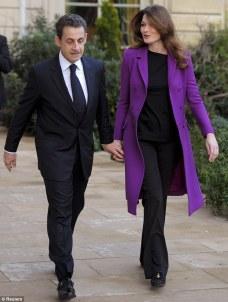 Carla Bruni-Sarkozy Cute Outfit- Purple Coat with All Black Ensemble