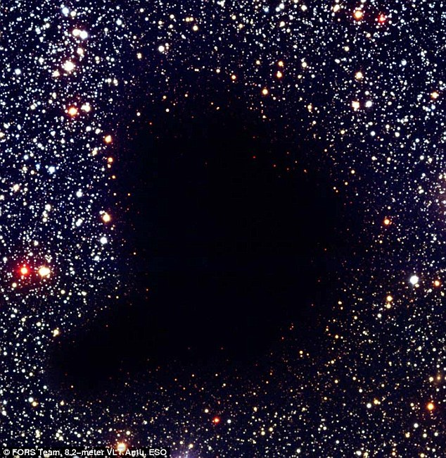 Eerie: Rather than being a massive vacuum in the universe, the eerily dark 'hole' is known to astronomers as a dark molecular cloud