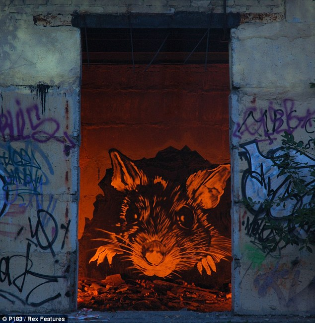 Urban hazard: A giant rat appears to be peering out from a hellish underworld in this piece