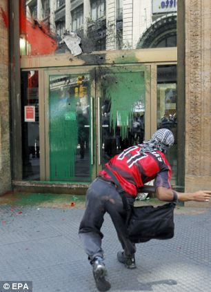 A paint bomb is lobbed at HSBC in Buenos Aires, Argentina, as protesters rally against Prince William's visit to the Falklands