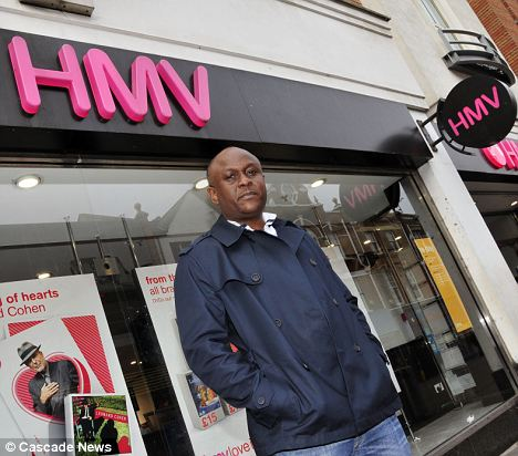 Sacked: Charles Oloro outside the HMV store where he worked until he was fired for apprehending a shoplifter who had already made it through the front door