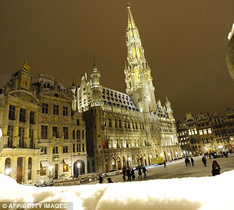 A view of the central Grand Palace and Grote Market square after a snow fall, in Brussels