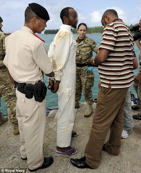 Captured: Royal Navy sailors have detained a Somali pirate dubbed Six Toe Joe because he has an extra digit on each foot