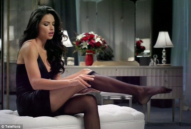 Racy: The brunette beauty seduced the eyes of close to a hundred million viewers around the globe as she was seen getting ready for a hot date in her Teleflora Super Bowl ad