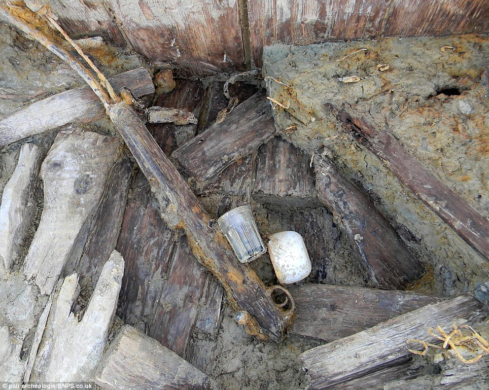A drinks cup and the remains of a rifle that have survived almost intact for a century. Archaeologists believe the items have been so well-preserved because hardly any air, water or lights penetrated the trench