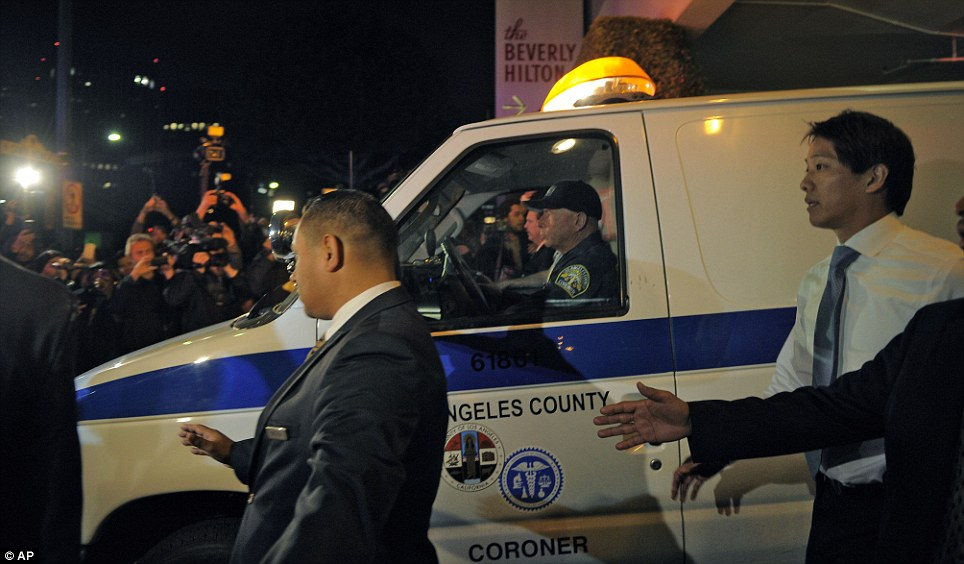 A coroner's van leaves the Beverly Hilton Hotel in Los Angeles, California, this morning where Whitney Houston was found dead