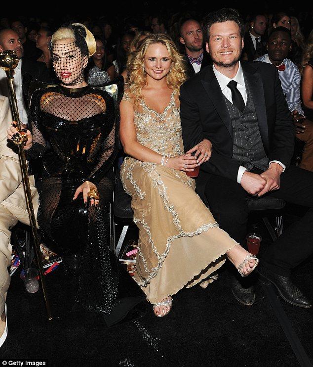 In the audience: Miranda Lambert and her husband Blake Shelton (R) were sat next to an ornately dressed Lady Gaga