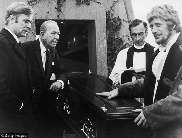 Flashback: One of Kelly's first roles was a vicar on the The Italian Job in 1969, alongside Michael Caine and Noel Coward, with director Peter Collinson