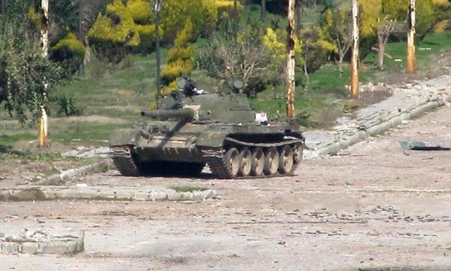 Warzone: Syrian army tanks are now a regular sight on the streets of Homs, as Assad continues to fight the 11-month uprising