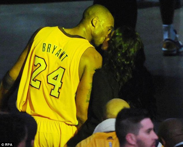 Caught on camera: Kobe Bryant was spotted kissing his estranged wife Vanessa Bryant after his team the LA Lakers defeated the Atlanta Hawks at the Staples Centre last night