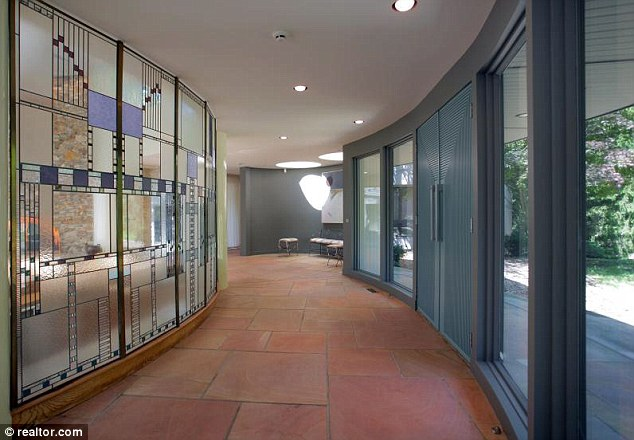 Decorative: One curved corridor boasts a stained glass style decoration running alongside a red tile floor