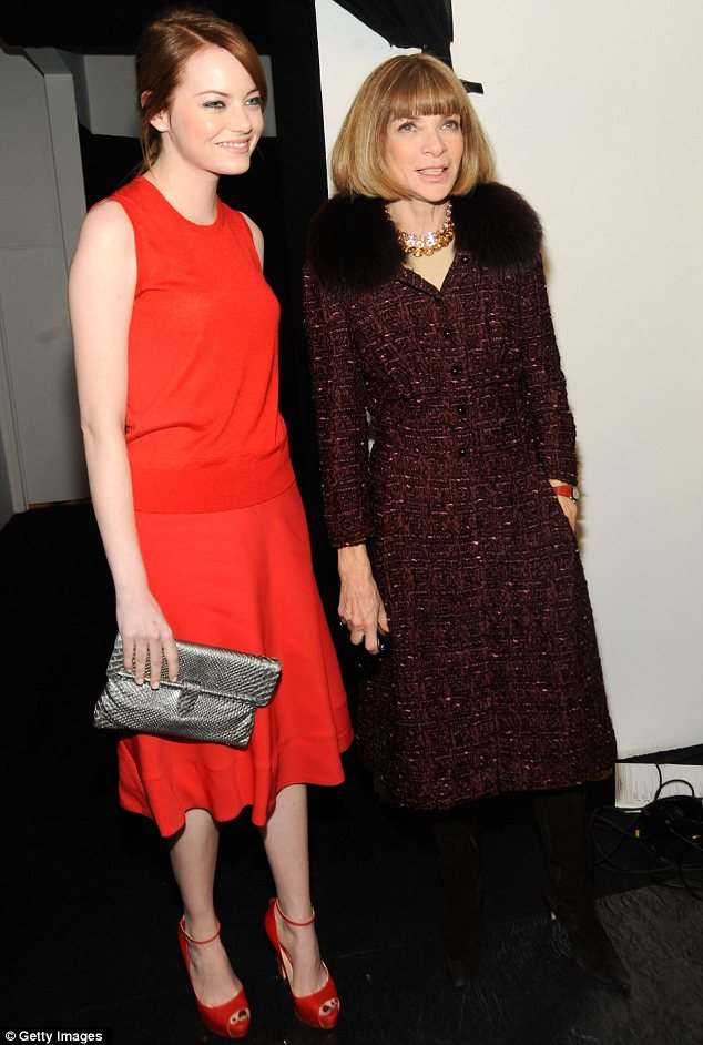 Fashion fans: Emma dissected the show backstage with US Vogue editor Anna Wintour