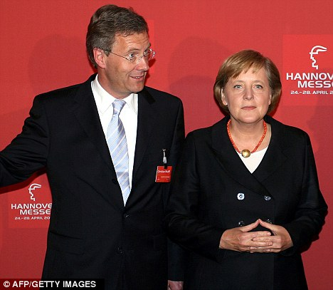 Close: Christian Wulff, pictured with German Chancellor Angela Merkel, has been forced to resign after trying to gag newspapers investigating political favours