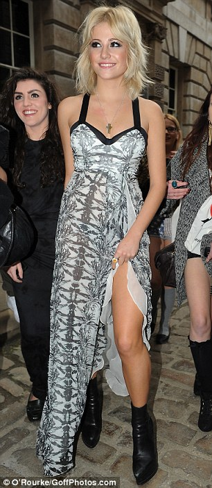 Pixie on parade: Miss Lott arrived at the first day of LFW in a long black and white print dress but changed into a short black dress and shiny coat for the afternoon