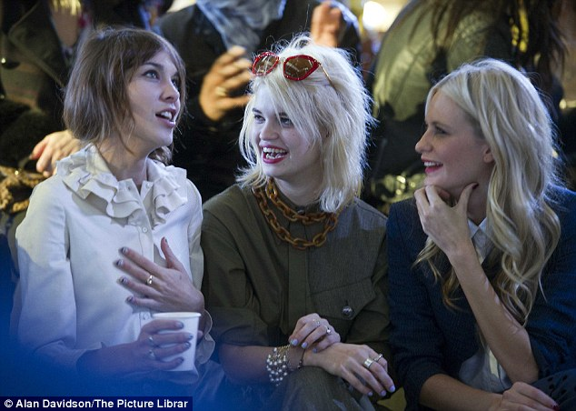 Riveting: Alexa, Pixie and Poppy kept themselves entertained as they waited for the show to begin