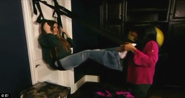 Getting by with a little help from her friend: Malika helps Khloe set up her second sex swing