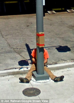 A man in Toronto sit with a lamppost for company