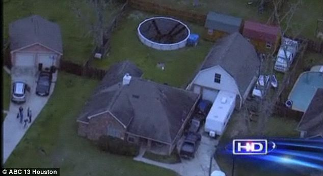 Scene: The 11 children and 10 adults were found living in this Dayton, Texas home and all of the kids shared a 10-by-10 room with no electricity and boarded-up windows