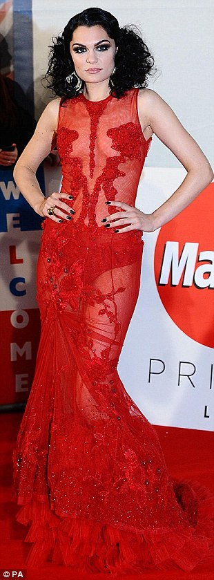 Showing some skin: Jessie J opted for a sheer red number, showing off her pants underneath