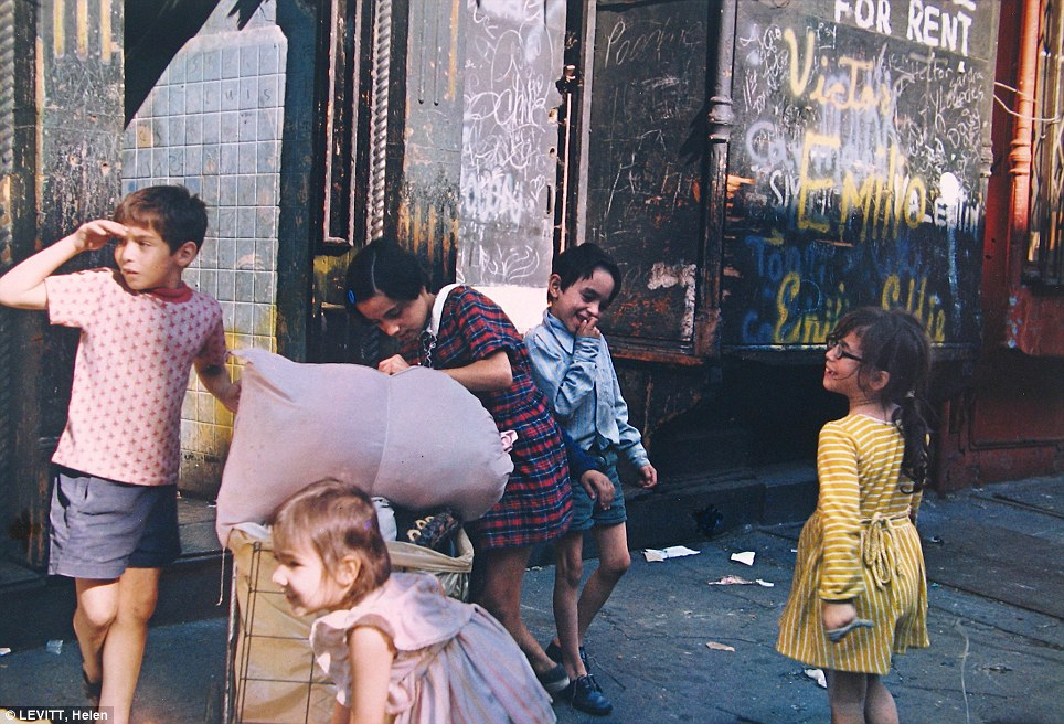Growing up in New York: Kids with laundry play on a city street in 1972