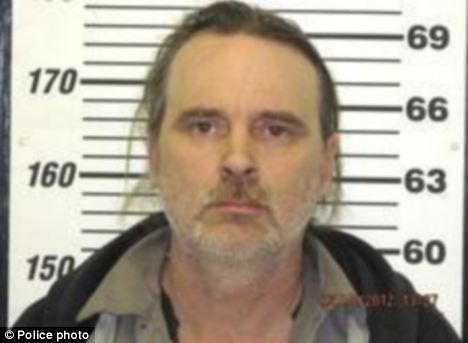 Accused: Michael Gilman is accused of chaining his stepdaughter to a bed for five weeks