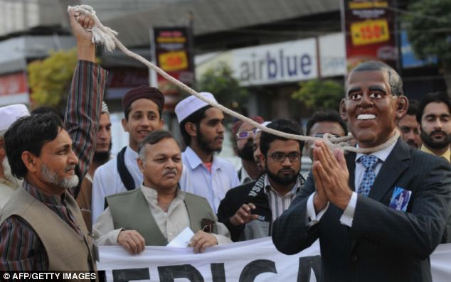 Spreading: Anti-US protests have caught on in Pakistan as a demonstrator wears a mask of US President Barack Obama