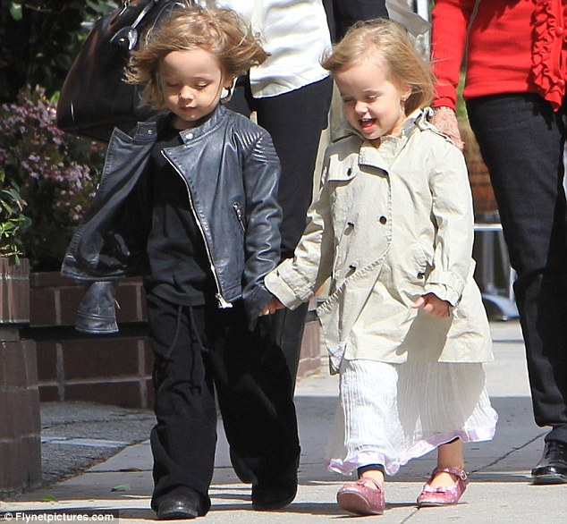 Super cute: While Knox looked like a little Brad Pitt in his all-black outfit and mini leather jacket, Vivienne went for a more girly appearance in a white floaty skirt and pink sparkly pumps