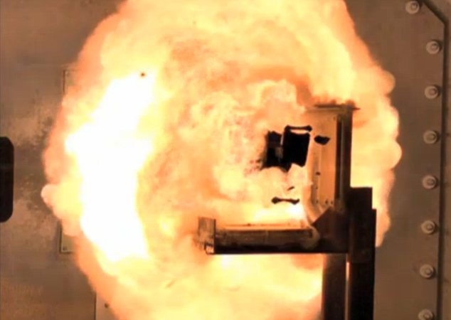 Sonic boom: An industry-built prototype of the electromagnetic railgun, seen here firing a projectile, is now being tested by the U.S. Navy