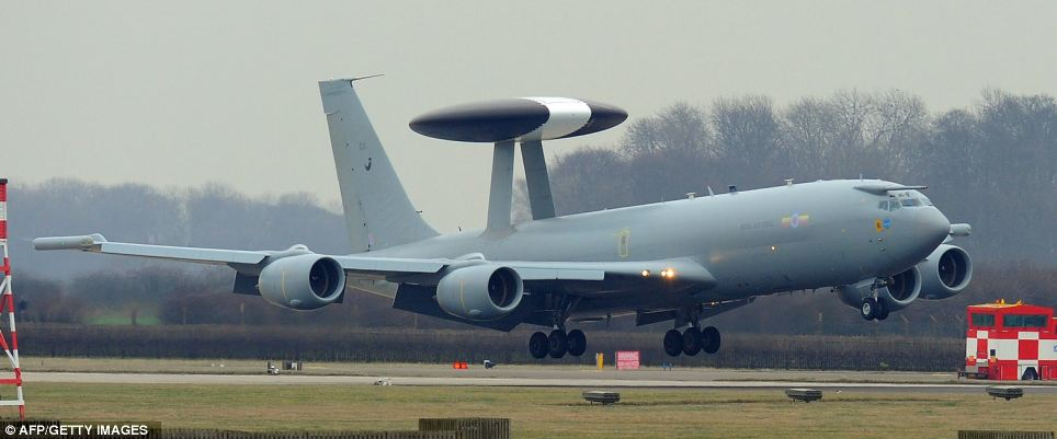 Keeping a watch: A British Royal Air Force E-3D Sentry AEW aircraft has the distinctive dome above the fuselage which houses pulse-Doppler detector which revolves six time per minute to pick up dozens of airborne and land threats from hundreds of miles