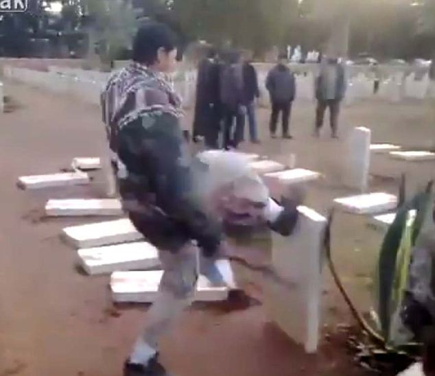 Senseless: A man kicks down headstones of soldiers