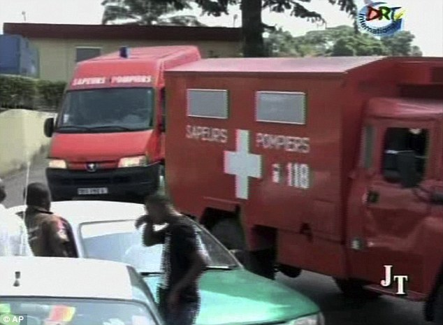 Emergency: Ambulances were sent across the city as they desperately tried to treat people wounded in the blasts and free those trapped under buildings