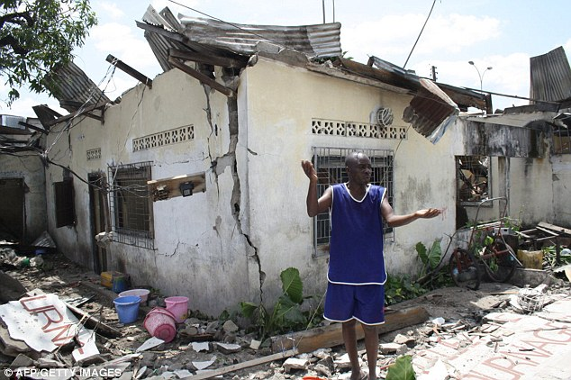 Damage: Homes across Brazzaville were left in tatters today after a series of explosions at a munitions depot