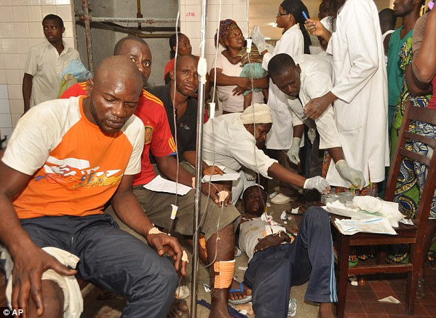 Treatment: A hospital in Brazzaville is packed with people injured after explosions rocked the city today