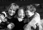Happy: Kalanit Levy, pictured with her brothers, was born with Down Syndrome after a botched prenatal test failed to spot the condition. Her parents are now suing for the costs of her extra care