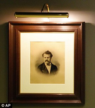 Creative forces: A 1892 portrait drawing of Louis Vuitton (left), who started his career as a bag packer for the Parisian elite before starting his own luggage company, hangs with a photograph of Marc Jacobs
